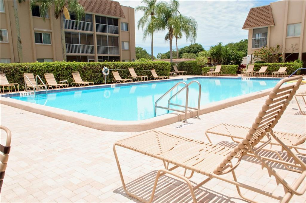 Beautiful Pool Heated at 82 Degrees Year Round! - Condo for sale at 1310 Glen Oaks Dr E #388e, Sarasota, FL 34232 - MLS Number is A4182635