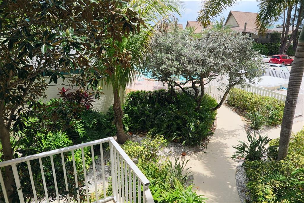 View from outside unit toward the east. - Condo for sale at 100 73rd St #202a, Holmes Beach, FL 34217 - MLS Number is A4184505