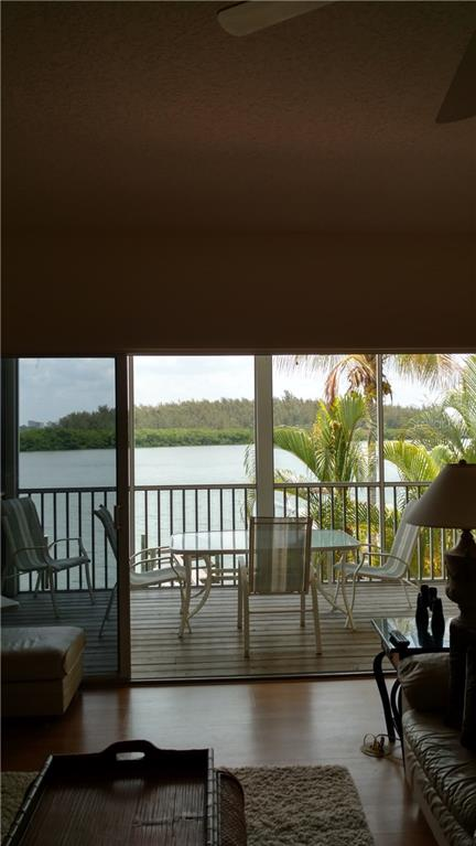 View from living room - Condo for sale at 9209 Midnight Pass Rd #5, Sarasota, FL 34242 - MLS Number is A4185067