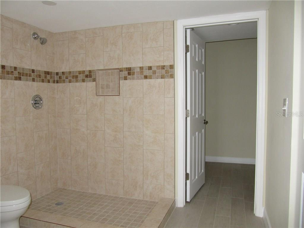 Master Shower and walk-in closet - Condo for sale at 6440 Mourning Dove Dr #404, Bradenton, FL 34210 - MLS Number is A4185069