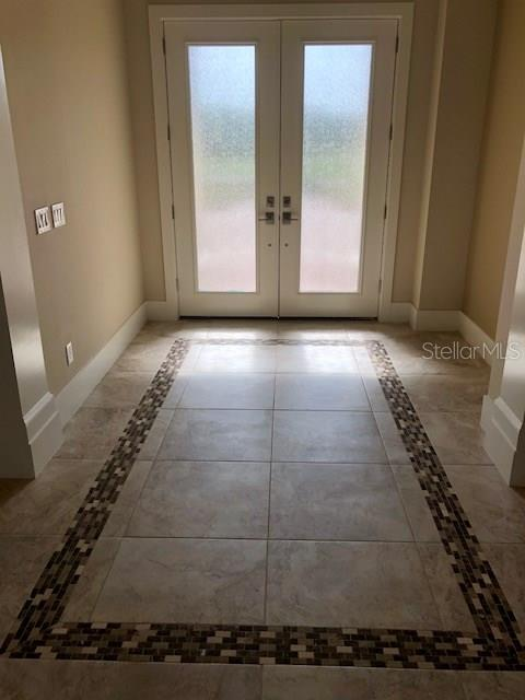 Spacious Foyer with beautiful Tile work. Great for opening your doors and inviting in your guests - Single Family Home for sale at 4046 Mayors Ct, Sarasota, FL 34240 - MLS Number is A4185203