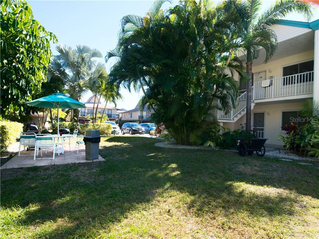 Back picnic area - Condo for sale at 100 73rd St #204a, Holmes Beach, FL 34217 - MLS Number is A4185340
