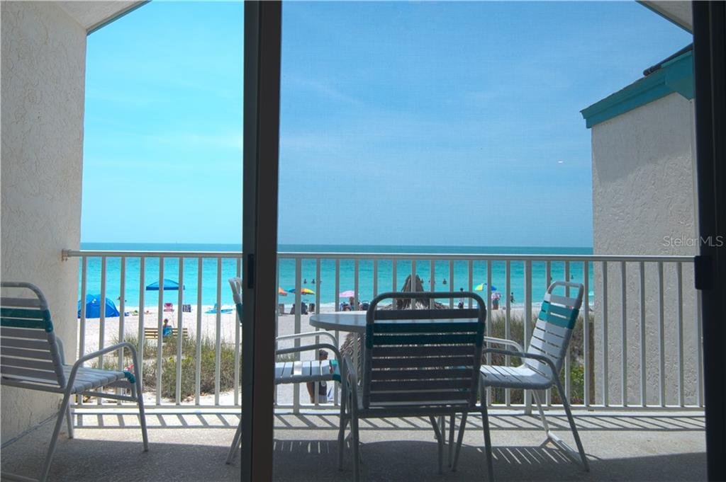 View from the living room over the deck - Condo for sale at 100 73rd St #204a, Holmes Beach, FL 34217 - MLS Number is A4185340