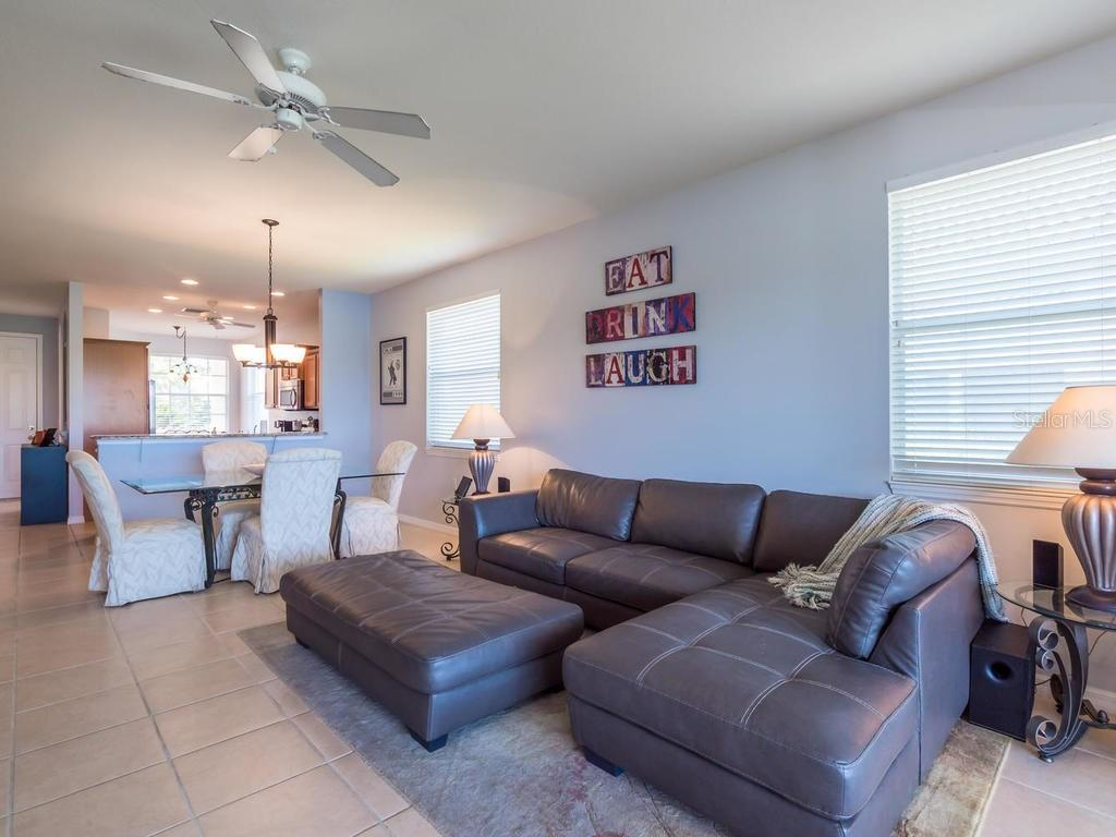 Living/dining room - Single Family Home for sale at 4294 Reflections Pkwy, Sarasota, FL 34233 - MLS Number is A4185695
