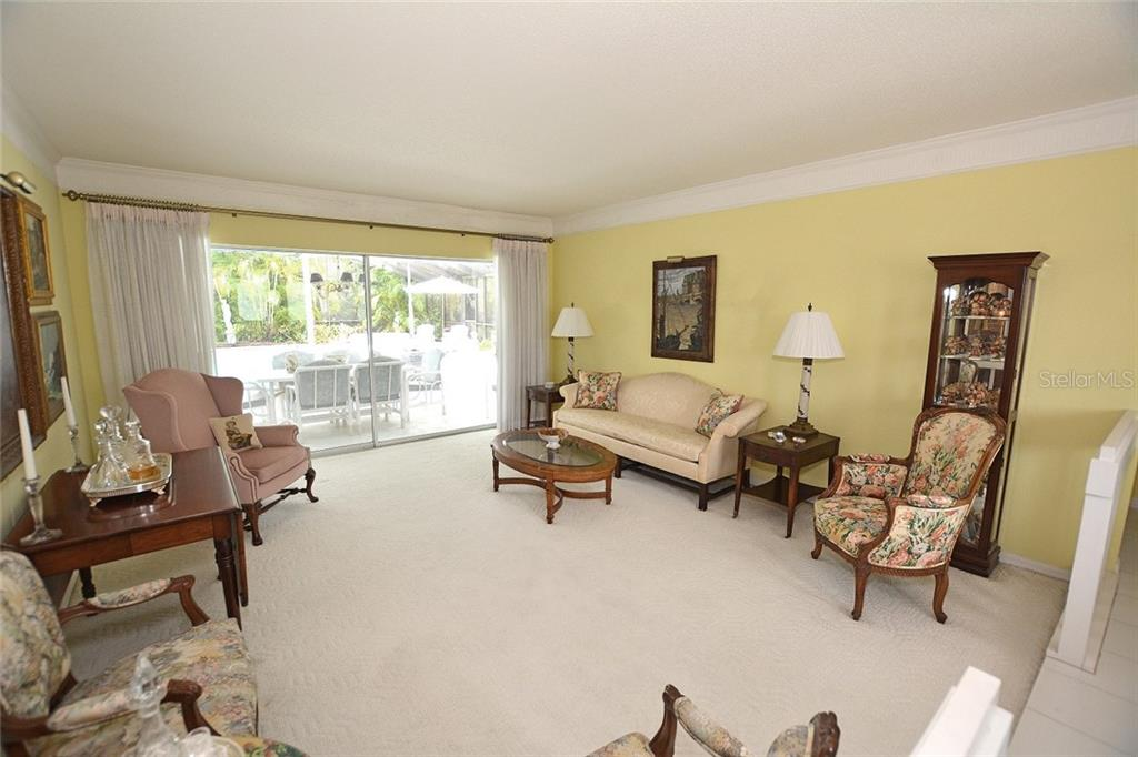 Nice entertaining space in this large formal living room with easy access to the outdoors. - Single Family Home for sale at 1157 Wyeth Dr, Nokomis, FL 34275 - MLS Number is A4185839