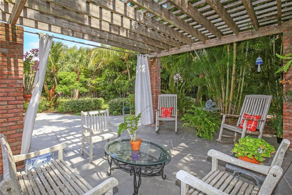 Relax in the shade of the pergola while truly enjoying the fantastic gardens of this home. - Single Family Home for sale at 3765 Beneva Oaks Blvd, Sarasota, FL 34238 - MLS Number is A4185879