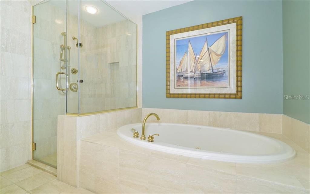 Master bathroom with jetted tub and walk-in shower - Condo for sale at 1310 Old Stickney Point Rd #e53, Sarasota, FL 34242 - MLS Number is A4186018