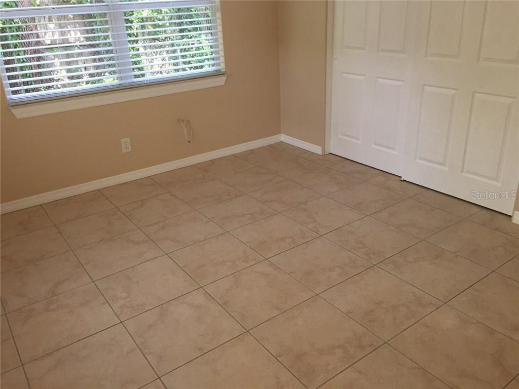 Ceramic tile throughout the home except for the dining room. - Single Family Home for sale at 938 Highland St, Sarasota, FL 34234 - MLS Number is A4186423