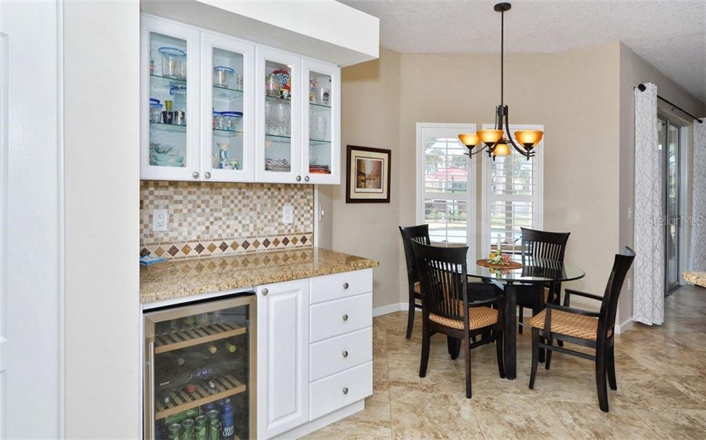 Wine cooler and lite stemware  cabinet with stone countertop - Single Family Home for sale at 4121 Via Mirada, Sarasota, FL 34238 - MLS Number is A4186485