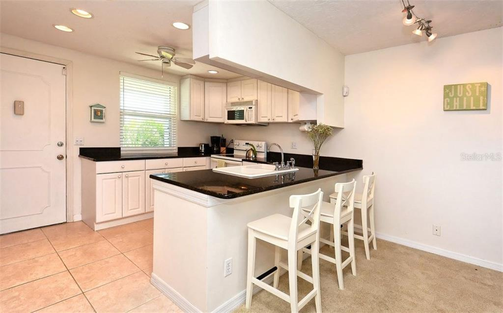 Kitchen Breakfast Bar Area. - Condo for sale at 4330 Falmouth Dr #307, Longboat Key, FL 34228 - MLS Number is A4187329