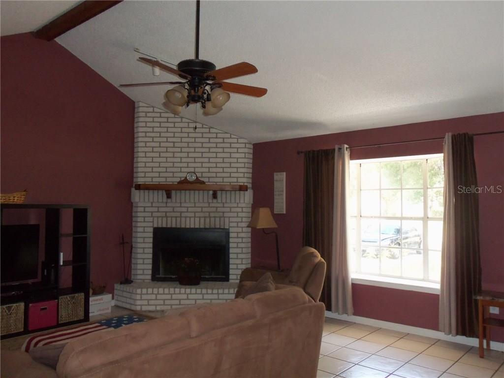 13511 3rd Ave E .....Large Great Room with vaulted ceilings, ceramic tile floor and a fireplace - Single Family Home for sale at 13511 3rd Ave E, Bradenton, FL 34212 - MLS Number is A4187462