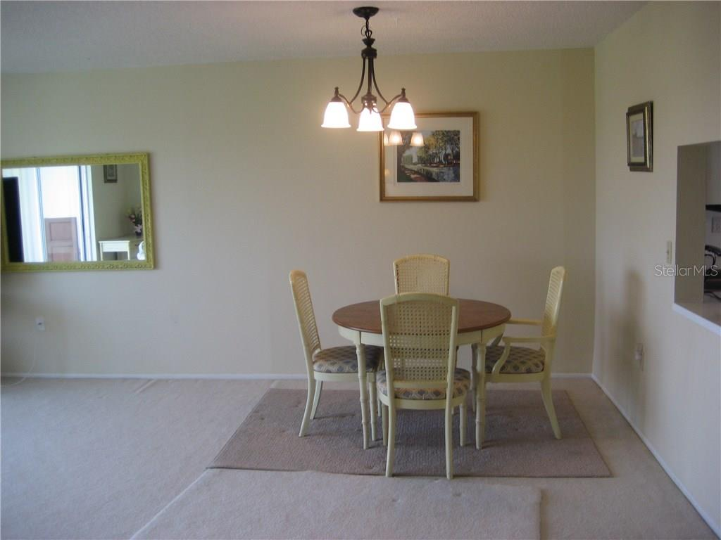 Dining area with pass through to the kitchen on the right - Condo for sale at 3820 Ironwood Ln #606i, Bradenton, FL 34209 - MLS Number is A4187664