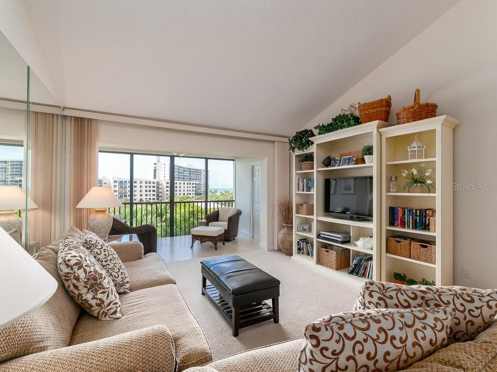 Living room with enclosed balcony - Condo for sale at 6236 Midnight Pass Rd #406, Sarasota, FL 34242 - MLS Number is A4188093