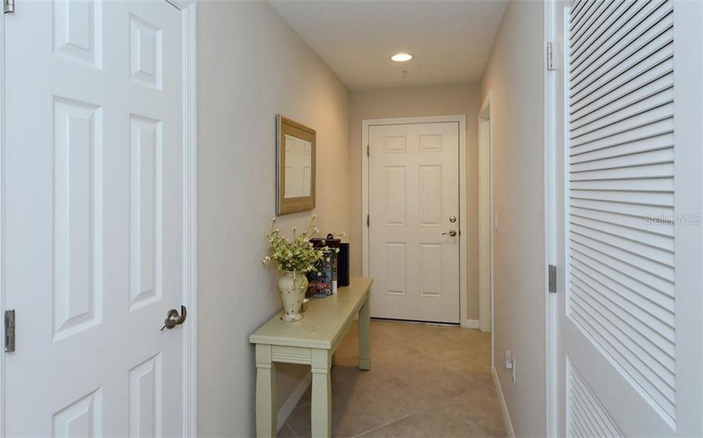 Entry hallway - Condo for sale at 81 Navigation Cir #103, Osprey, FL 34229 - MLS Number is A4188370