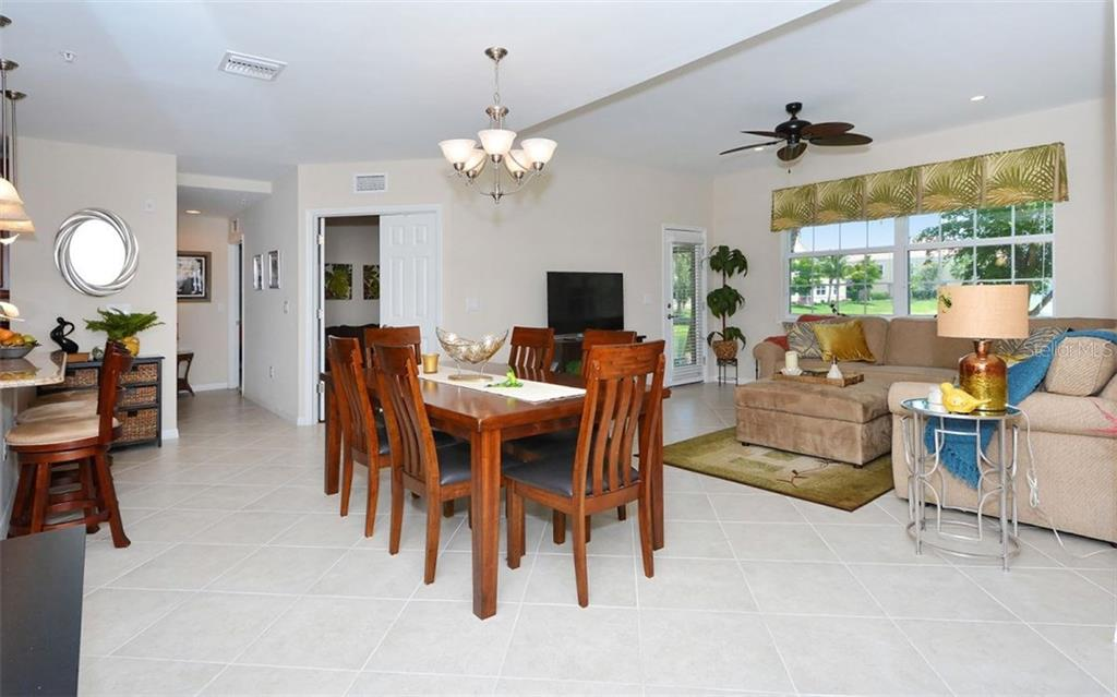 Great room - Condo for sale at 81 Navigation Cir #103, Osprey, FL 34229 - MLS Number is A4188370