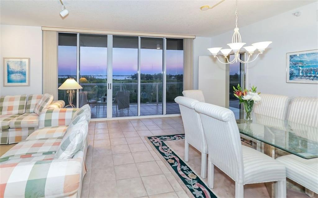 Dining room with views of the Bay - Condo for sale at 1800 Benjamin Franklin Dr #b507, Sarasota, FL 34236 - MLS Number is A4188540