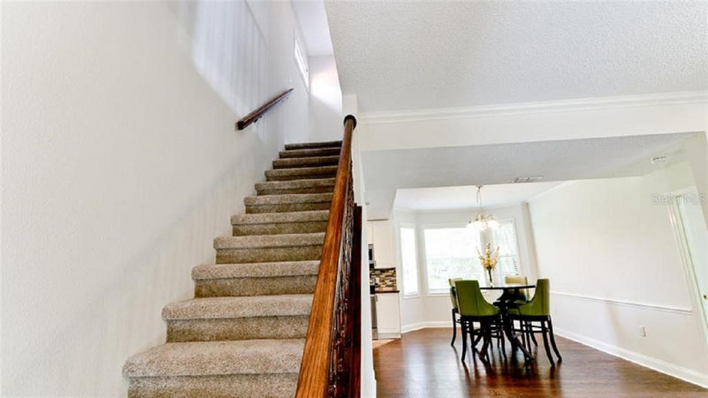 New Carpet on stairwell - Single Family Home for sale at 120 Whispering Oaks Ct, Sarasota, FL 34232 - MLS Number is A4188906