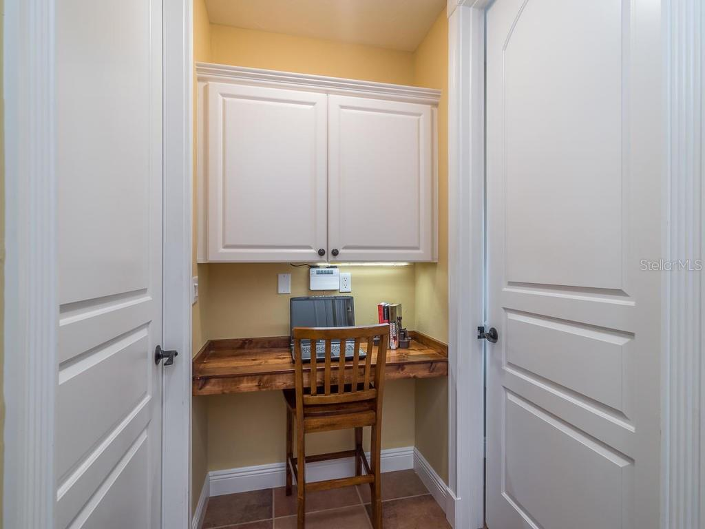 Charming desk space outside utility room. - Single Family Home for sale at 1884 Grove St, Sarasota, FL 34239 - MLS Number is A4189365