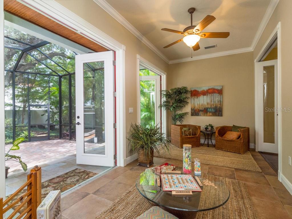 Enclosed, bonus Sun Room that opens fully to the indoors and outdoors.  Perfect for play room, reading room or office! - Single Family Home for sale at 1884 Grove St, Sarasota, FL 34239 - MLS Number is A4189365