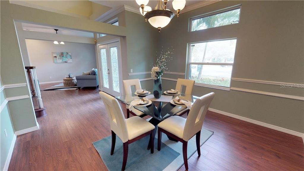 The light filled dining room - Single Family Home for sale at 9122 16th Avenue Cir Nw, Bradenton, FL 34209 - MLS Number is A4189396