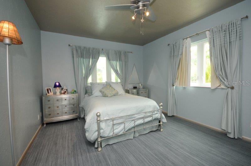 Master bedroom feels like a royal private retreat, with elegant soft colors. - Single Family Home for sale at 3319 Mayflower St, Sarasota, FL 34231 - MLS Number is A4189488