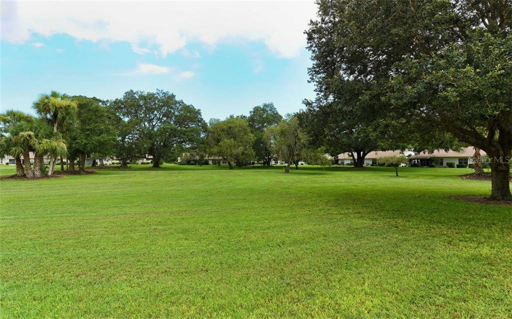 Vast green spaces throughout - Villa for sale at 4248 Oakhurst Cir E #3066, Sarasota, FL 34233 - MLS Number is A4192258
