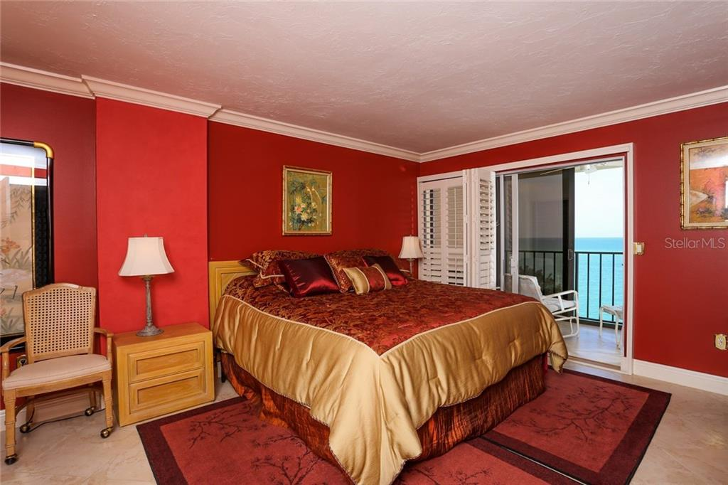 Master bedroom with sliders to Florida room and views of Gulf - Condo for sale at 20 Whispering Sands Dr #1103, Sarasota, FL 34242 - MLS Number is A4192663
