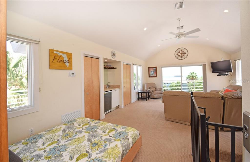 Another view of great room, murphy bed and wet bar. The view from this room is spectacular! - Condo for sale at 439 Beach Rd #e, Sarasota, FL 34242 - MLS Number is A4192797