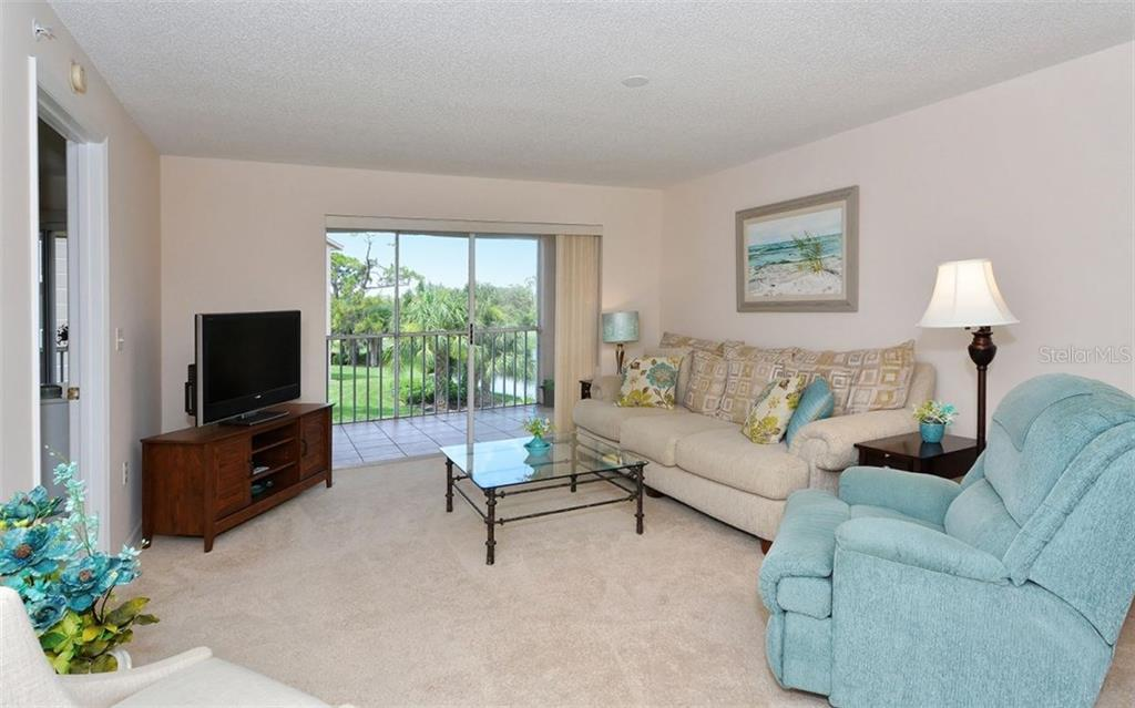 Living room overlooks the wonderful views. - Condo for sale at 9300 Clubside Cir #1201, Sarasota, FL 34238 - MLS Number is A4192821
