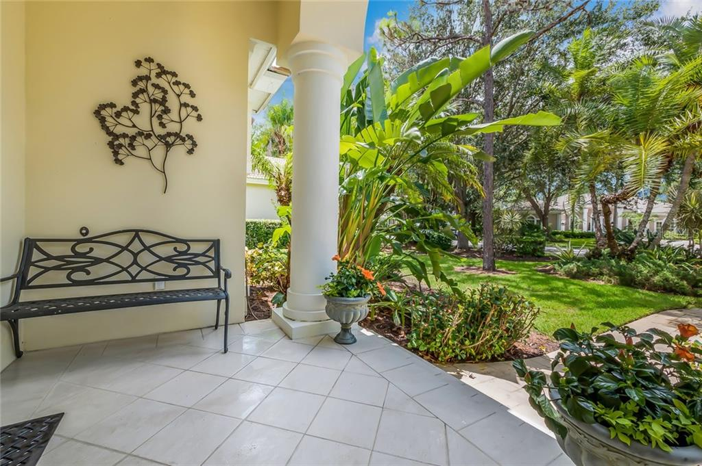 Stately columns at the entrance. - Single Family Home for sale at 8019 Collingwood Ct, University Park, FL 34201 - MLS Number is A4193802