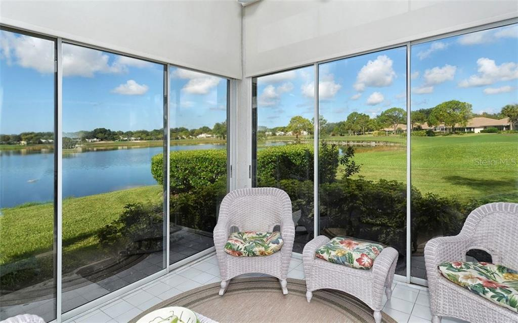 Spectacular water and golf course view from enclosed lanai. - Villa for sale at 604 Crossfield Cir #31, Venice, FL 34293 - MLS Number is A4193953
