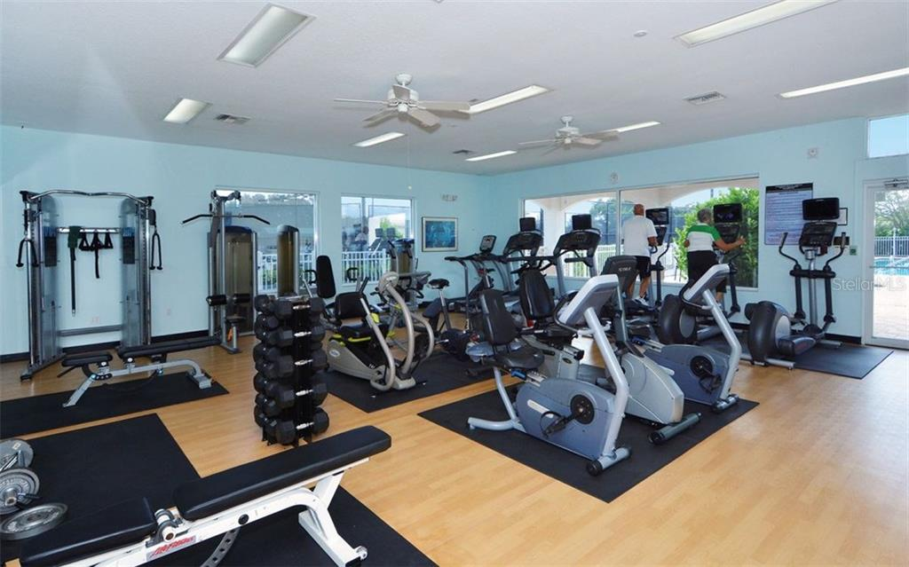 Stoneybrook Golf & Country Club fitness center. - Single Family Home for sale at 8747 Grey Oaks Ave, Sarasota, FL 34238 - MLS Number is A4195019