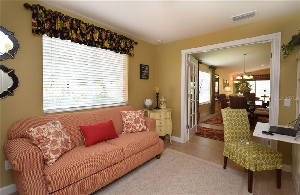 Comfortable Den easily becomes a 3rd. Bedroom - Villa for sale at 2127 Burgos Dr, Sarasota, FL 34238 - MLS Number is A4195921
