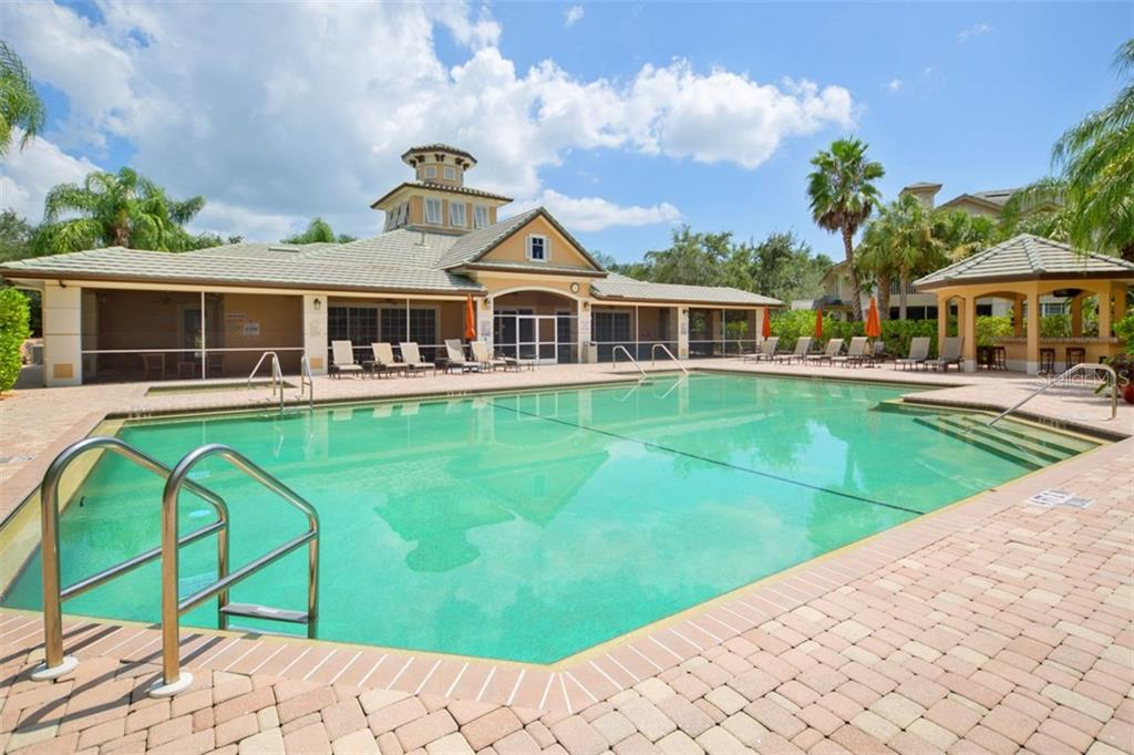 Clubhouse with pool, community room, fitness center, and tiki bar. - Condo for sale at 6415 Moorings Point Cir #102, Lakewood Ranch, FL 34202 - MLS Number is A4196054