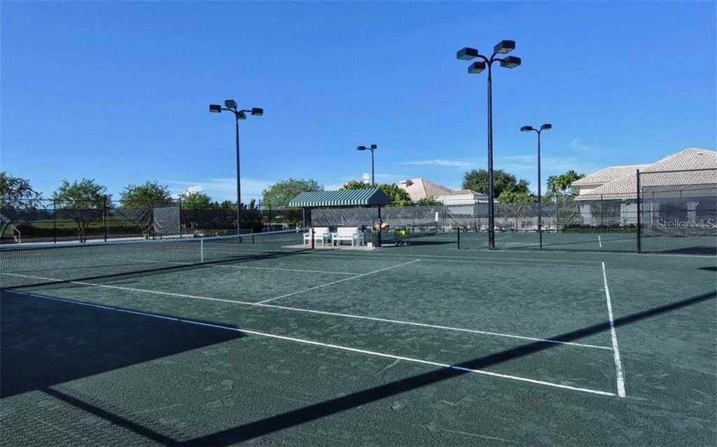Stoneybrook Golf & Country Club lighted har-tru surface tennis courts. - Condo for sale at 9570 High Gate Dr #1712, Sarasota, FL 34238 - MLS Number is A4196327