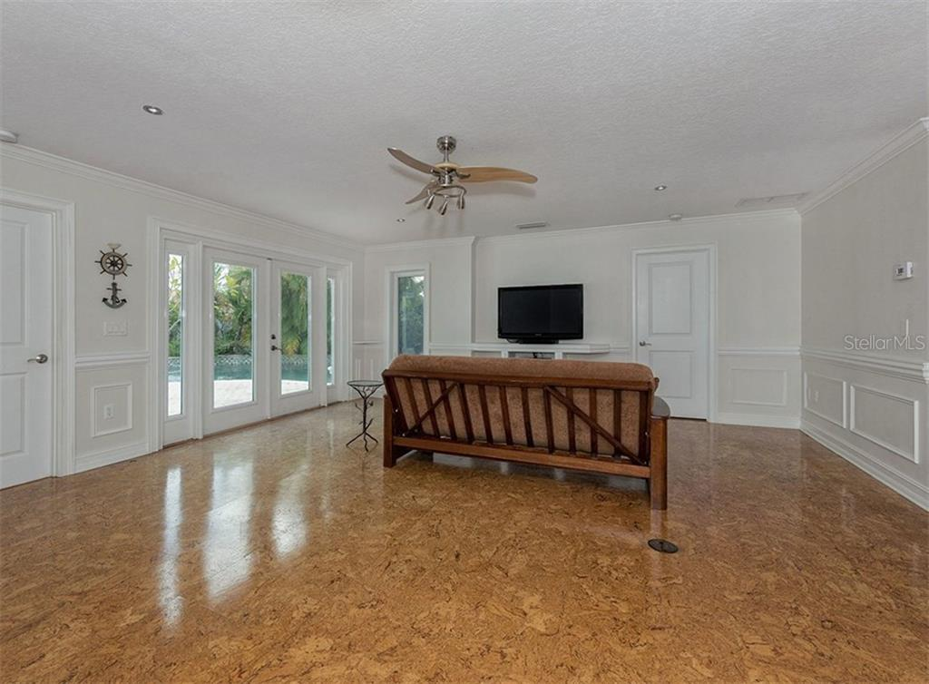Interior with doors to pool - Single Family Home for sale at 416 Mahon Dr, Venice, FL 34285 - MLS Number is A4196787
