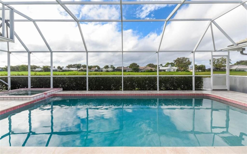Large Pool and Spa Over Look Fabulous Water Views and the Award Winning Golf Course - Single Family Home for sale at 1632 Valley Dr, Venice, FL 34292 - MLS Number is A4197771