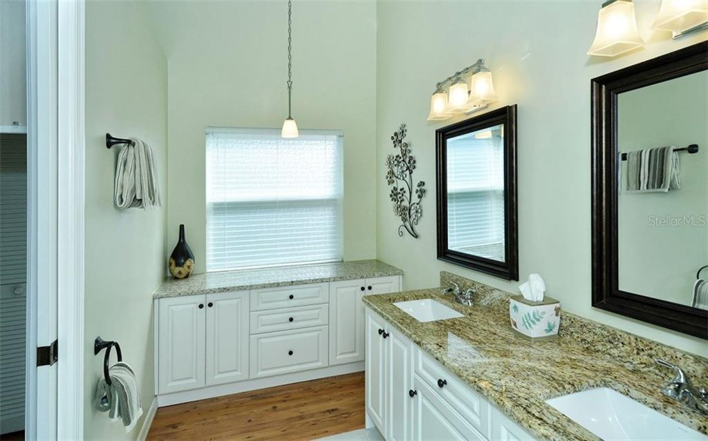 Upgraded master bath has double sinks and a lot of cabinets. Ceiling is vaulted here as well. - Single Family Home for sale at 9571 Knightsbridge Cir, Sarasota, FL 34238 - MLS Number is A4197972