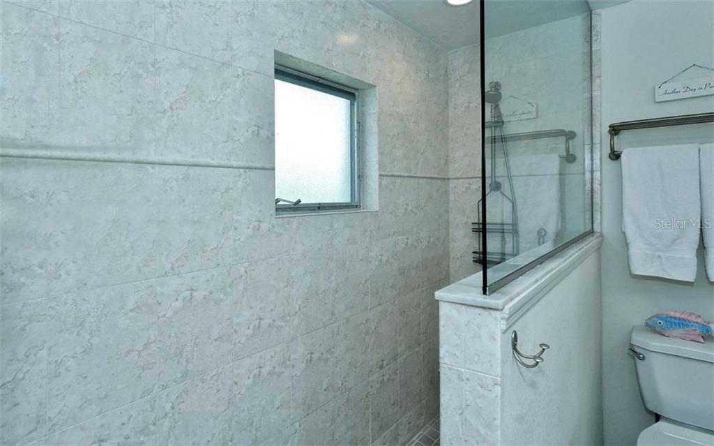Master bathroom shower - Single Family Home for sale at 6308 Midnight Pass Rd #4, Sarasota, FL 34242 - MLS Number is A4198360