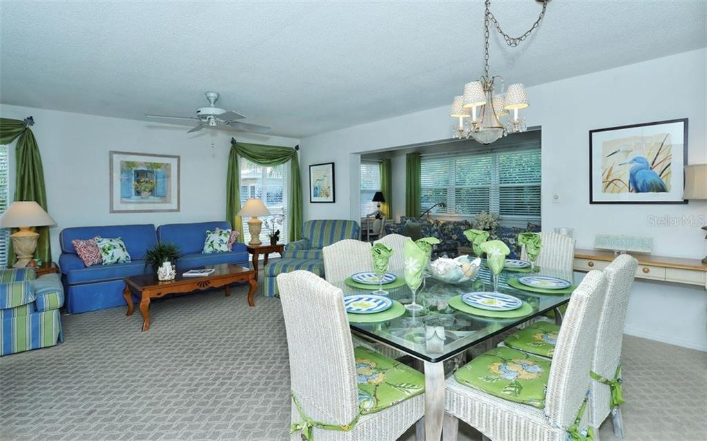 Living/Dining room - Condo for sale at 6308 Midnight Pass Rd #4, Sarasota, FL 34242 - MLS Number is A4198360