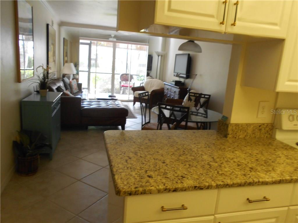 Kitchen view into Living/Dining area - Condo for sale at 5661 Midnight Pass Rd #403, Sarasota, FL 34242 - MLS Number is A4198451