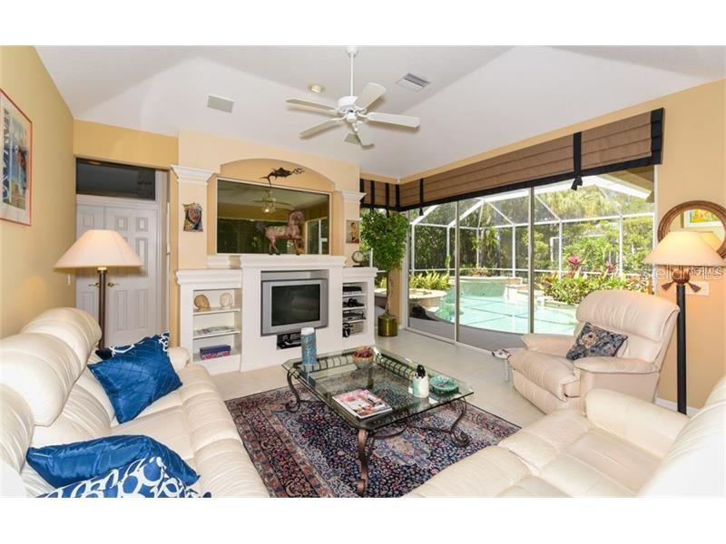 Family Room...Overlooking The Swimming Pool! - Single Family Home for sale at 6910 Treymore Ct, Sarasota, FL 34243 - MLS Number is A4198957