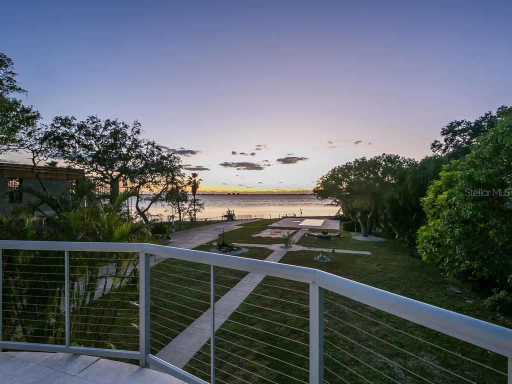 Beautiful sunset view from guest house patio - Single Family Home for sale at 4035 Bay Shore Rd, Sarasota, FL 34234 - MLS Number is A4199264