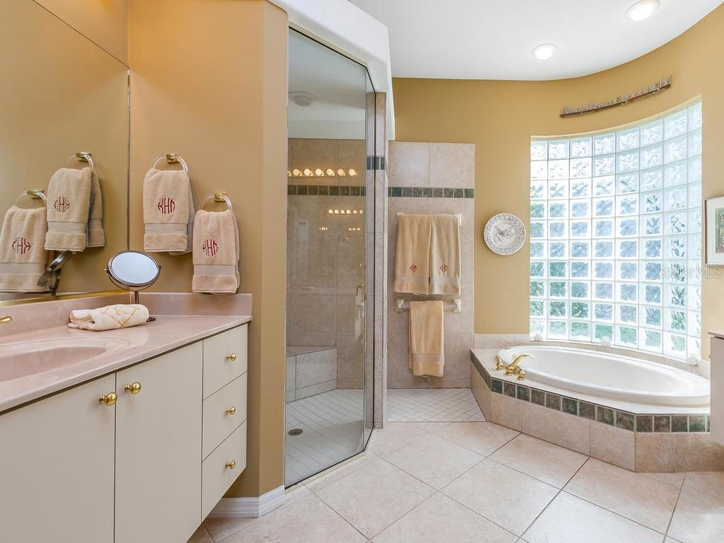 Great master suite, opens to lanai. Double closets with built-ins. - Single Family Home for sale at 4887 Carrington Cir, Sarasota, FL 34243 - MLS Number is A4199511