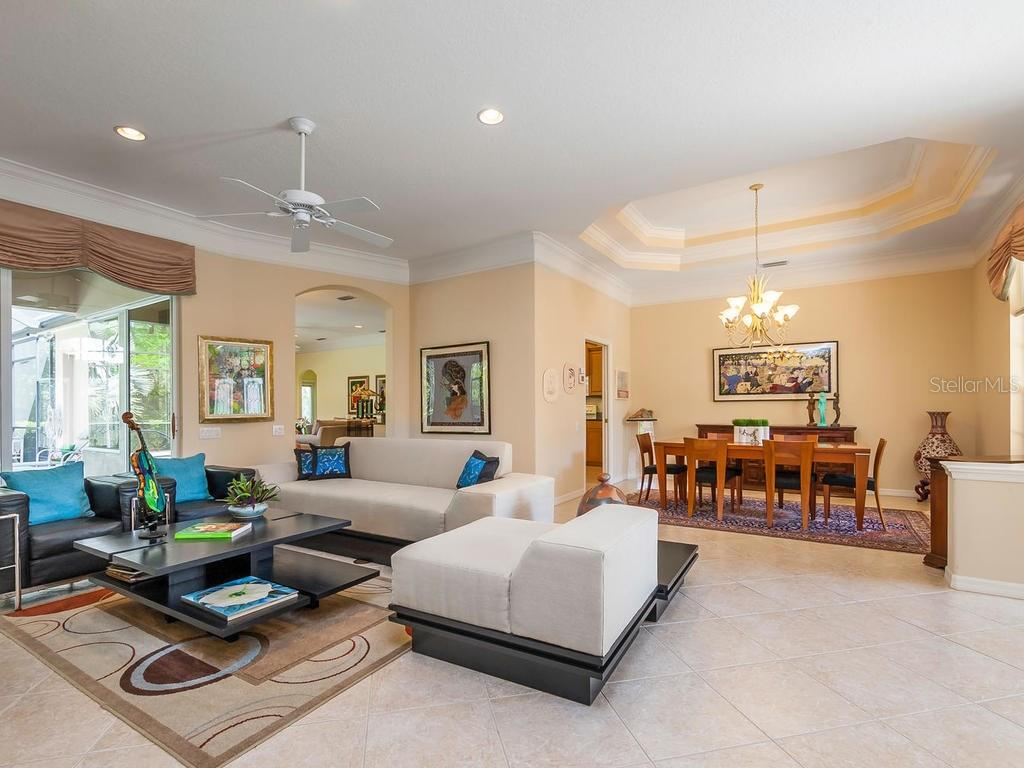 Open living and dinning area. - Single Family Home for sale at 4887 Carrington Cir, Sarasota, FL 34243 - MLS Number is A4199511