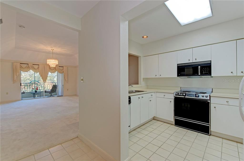 Upon entering front door ones immediately greeted with a light, bright, neutral palette that awaits them - Condo for sale at 3731 Sarasota Square #306-D, Sarasota, FL 34238 - MLS Number is A4199548