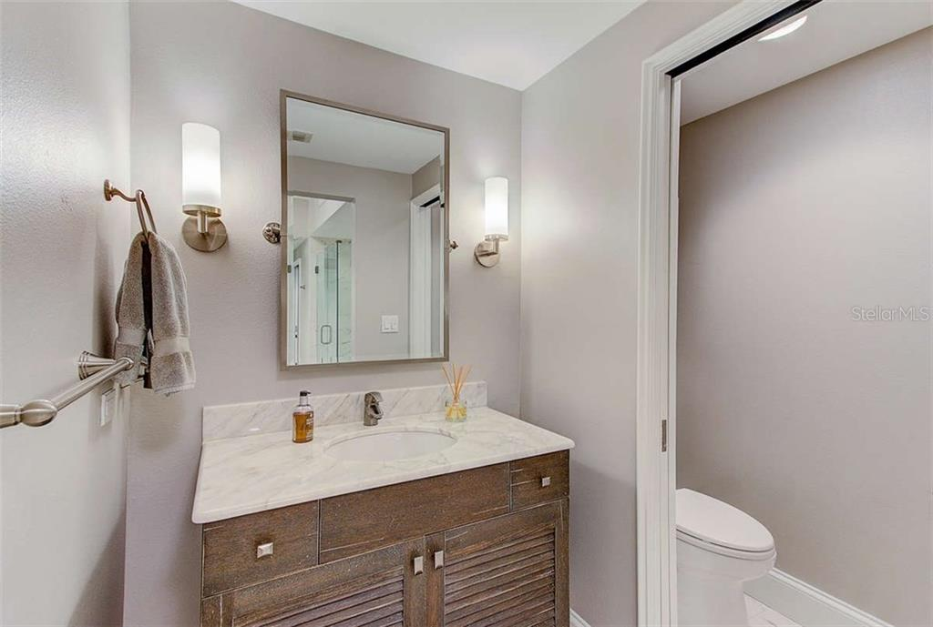 His Bath area - Condo for sale at 3060 Grand Bay Blvd #142, Longboat Key, FL 34228 - MLS Number is A4199568