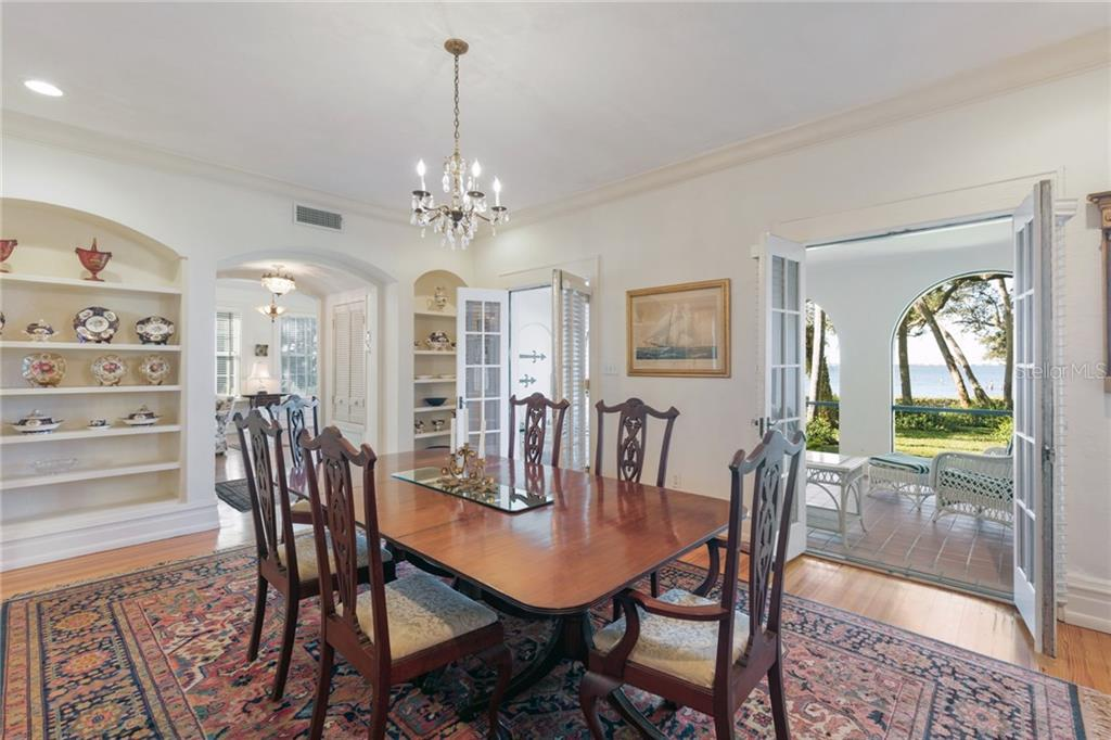 Formal dining room with many original details, picturesque views to the bay from almost all rooms - Single Family Home for sale at 3221 Bay Shore Rd, Sarasota, FL 34234 - MLS Number is A4200323