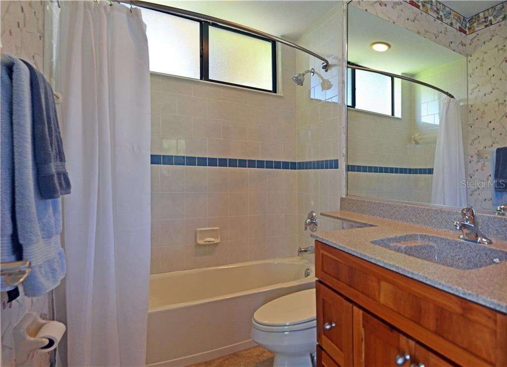 guest suite bathroom - Single Family Home for sale at 4616 Tuscana Dr, Sarasota, FL 34241 - MLS Number is A4200517