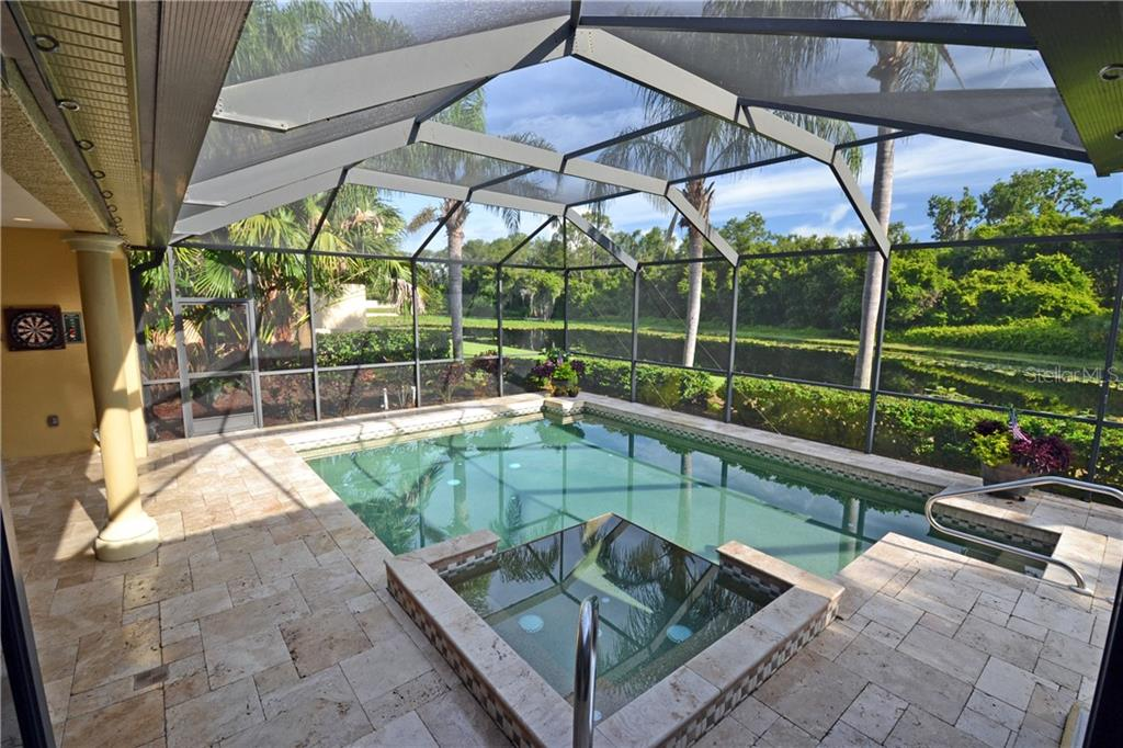 travertine patio, lake views, beautiful sunsets - Single Family Home for sale at 4616 Tuscana Dr, Sarasota, FL 34241 - MLS Number is A4200517